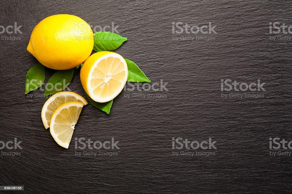 Lemon fruit on black slate background shot directly above stock photo