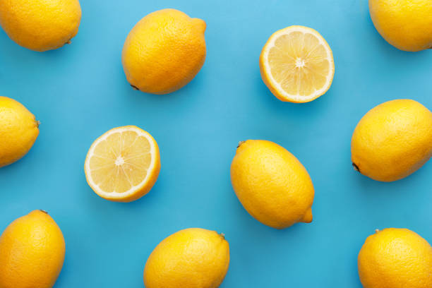 Lemon fruit pattern on turquise background. Repetition concept. Top view stock photo