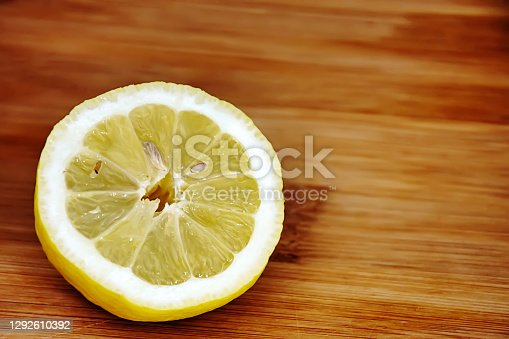 lemon half sliced on a wooden cutting board. Sour and citrus fruits. Mediterranean fruit source of vitamin C