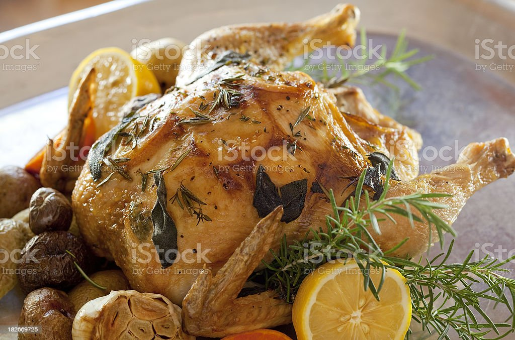 lemon herb chicken with vegetables stock photo