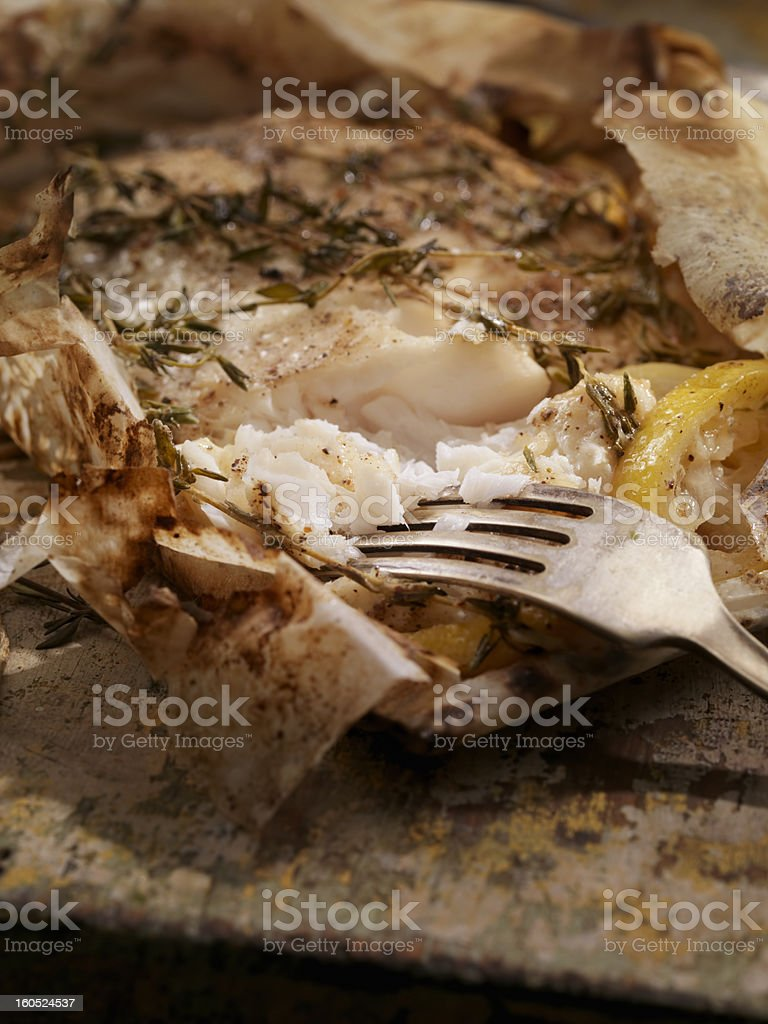 Lemon Herb Fish in Parchment Paper royalty-free stock photo
