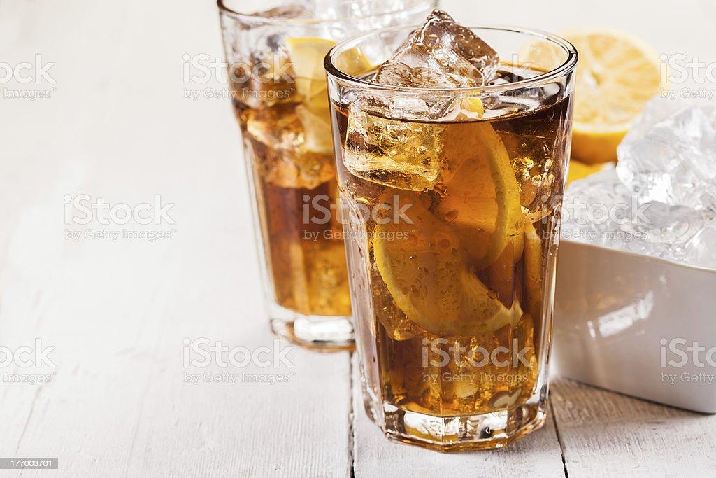 Lemon Ice Tea on white wooden table stock photo