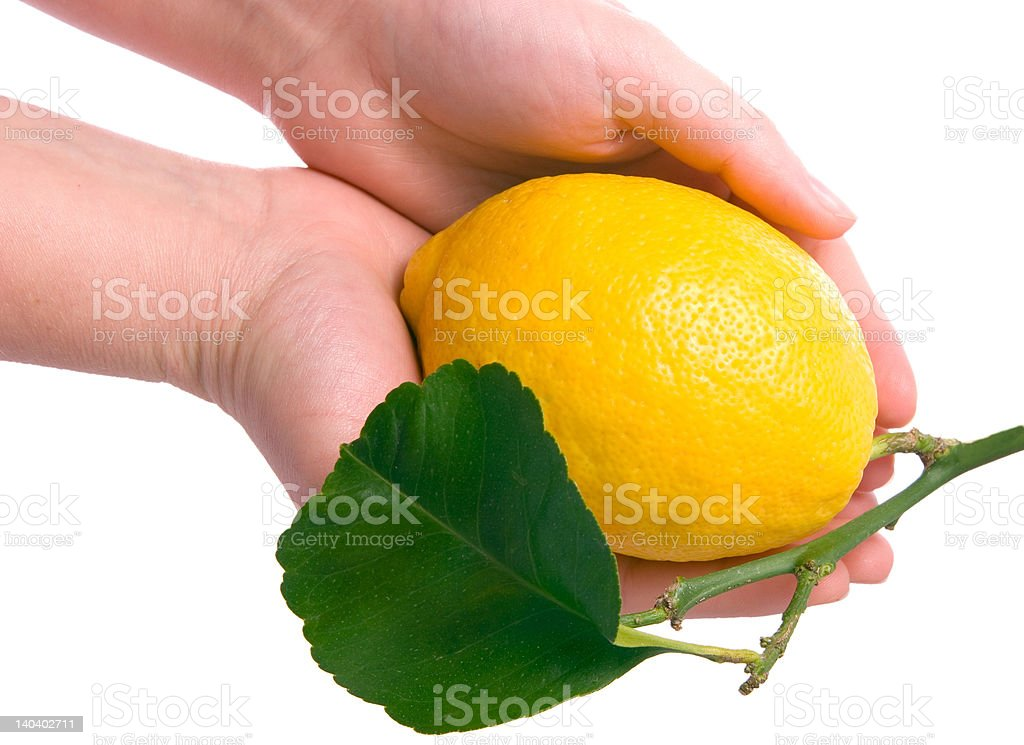 Lemon in girl hand isoolated on white royalty-free stock photo