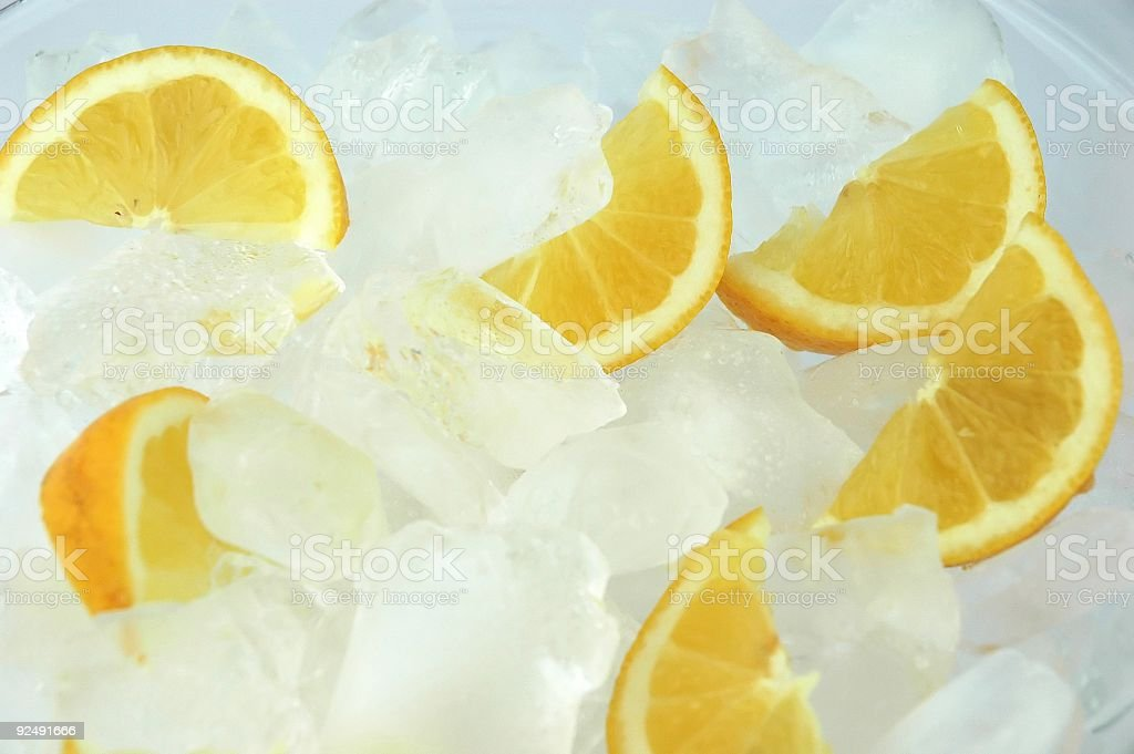 Lemon in the ice cubes royalty-free stock photo