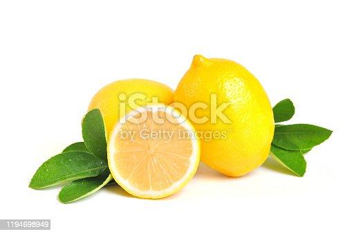 Lemon isolated on white background. Lemon fruit, vitamin C, Ripe juicy lemons, orange and green leaves on white background