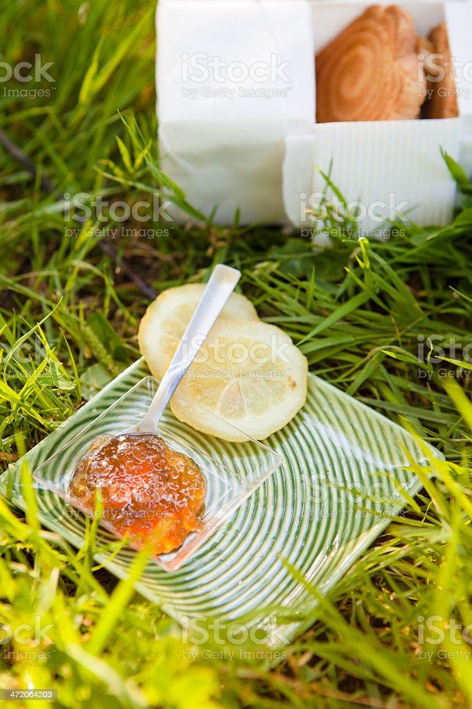 Lemon Jam on Grass From Above stock photo