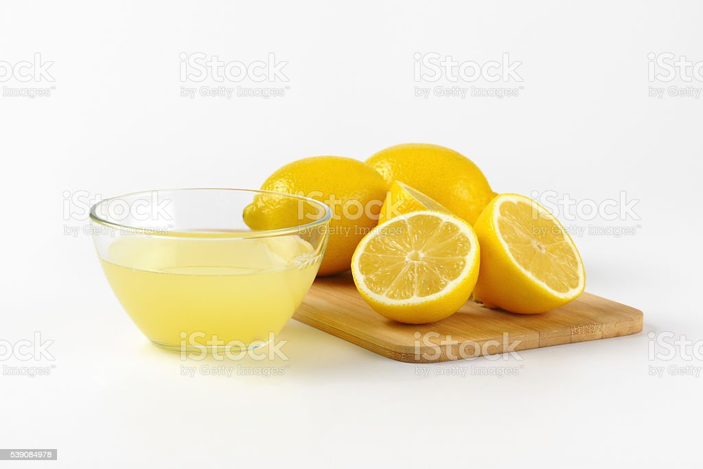 lemon juice and fresh lemons stock photo