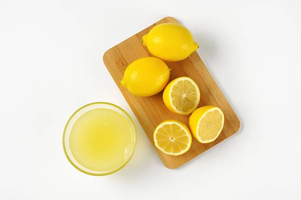 lemon juice and fresh lemons stock photo