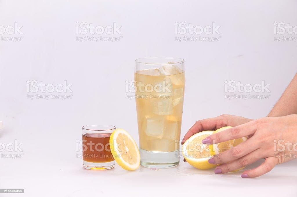 Lemon juice mixed with honey stock photo