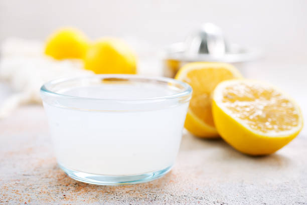 lemon juice lemon juice in glass and on a table lemon juice stock pictures, royalty-free photos & images