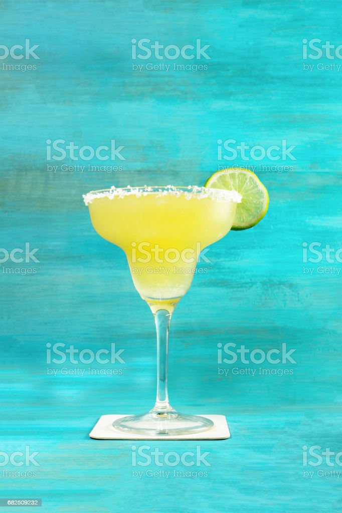 Lemon Margarita cocktail on vibrant turquoise with copyspace royalty-free stock photo