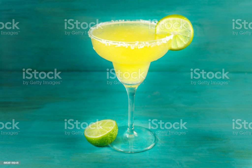 Lemon Margarita cocktails on vibrant turquoise with copyspace royalty-free stock photo