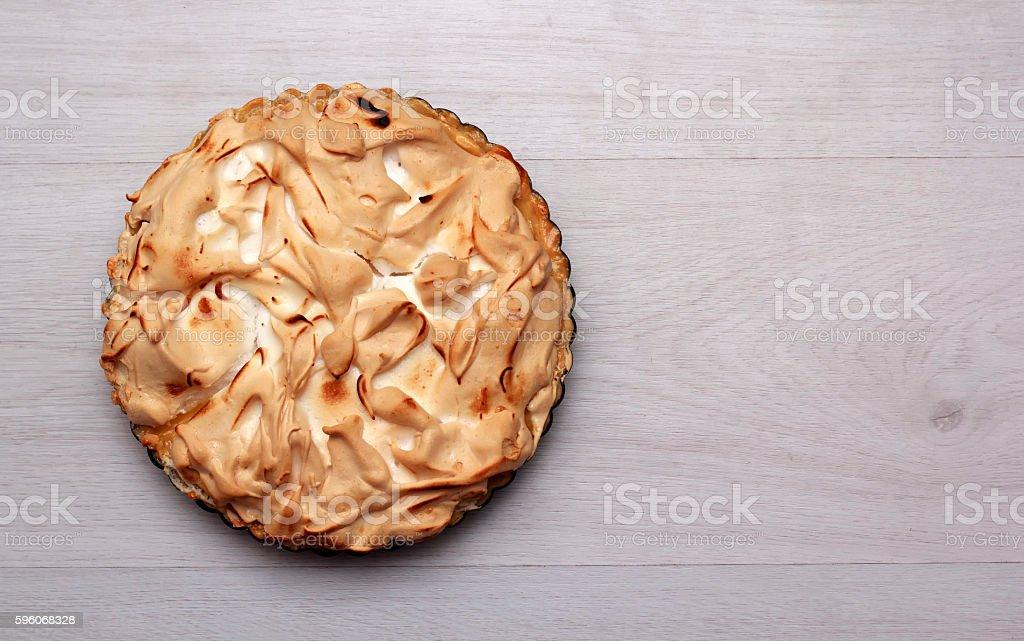 Lemon meringue pie on a cooling rack royalty-free stock photo