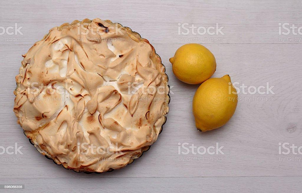Lemon meringue pie with fresh lemon royalty-free stock photo