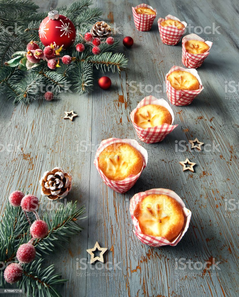Lemon mini muffins  on rustic table with Christmas decorations stock photo