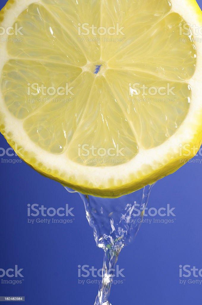 Lemon on blue royalty-free stock photo
