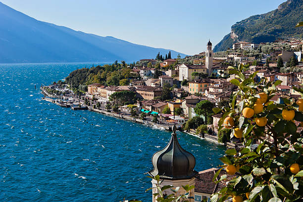 Limone sul Garda, Italy Limone sul Garda is a small town on the Brescia side of Lake Garda, nestled between the lake and the mountains, famous for its lemon groves, for the prized olive oil and the wonderful landscapes.  bell tower tower stock pictures, royalty-free photos & images