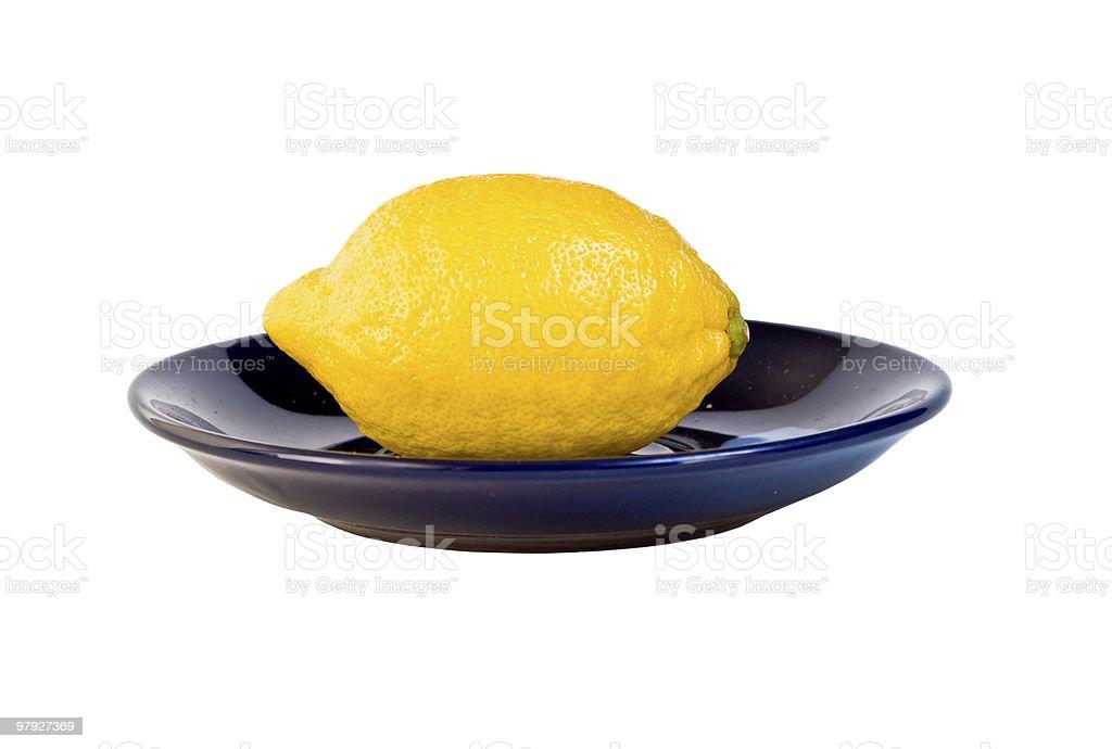 Lemon on plate royalty-free stock photo
