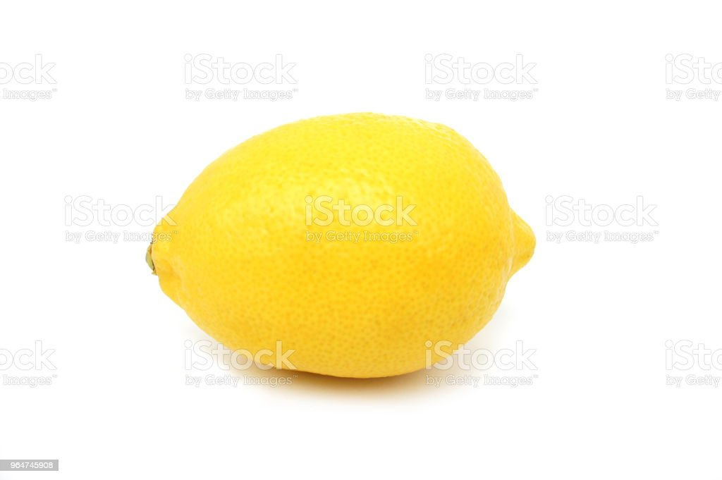 Lemon on white background with shadow. Side view. Close up. royalty-free stock photo