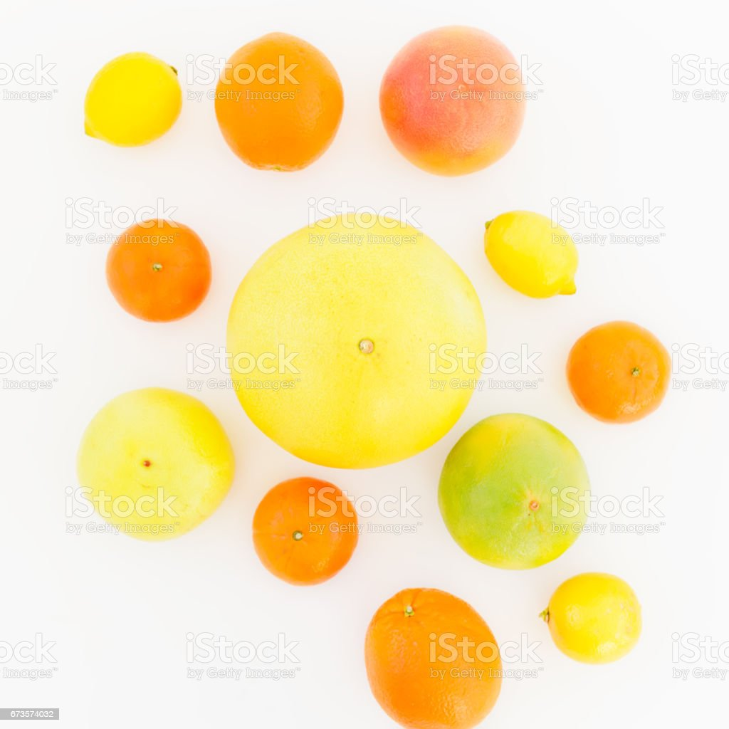 Lemon, orange, mandarin, grapefruit, sweetie and big pomelo fruit on white background. Flat lay, top view. royalty-free stock photo