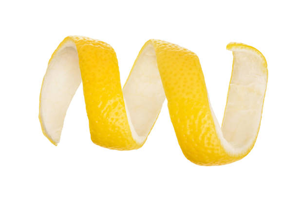lemon peel isolated on white background without a shadow. healthy food - twisted stock pictures, royalty-free photos & images