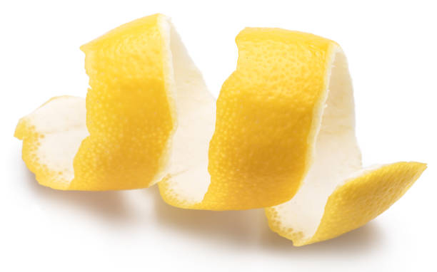 Lemon peel or lemon twist on white background. Close-up. stock photo