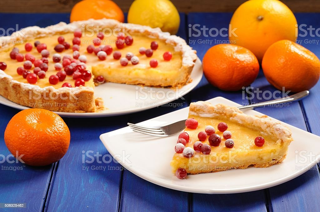 Lemon pie with condensed milk decorated with fresh cranberries stock photo