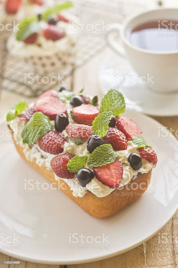 Lemon Pound Cake topped with fresh fruits. royalty-free stock photo