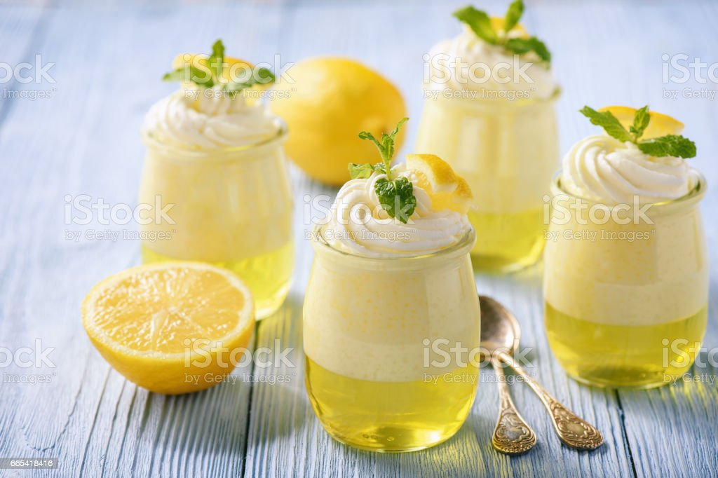 Lemon pudding with jelly on wooden background. stock photo