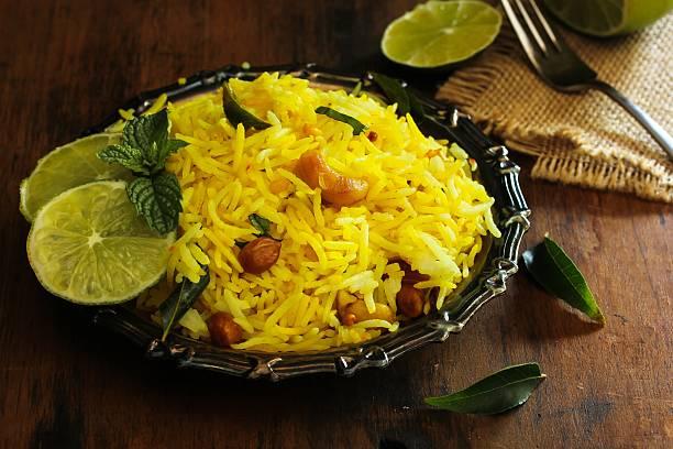Lemon rice / South Indian Rice dish with lemon stock photo
