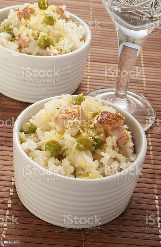 lemon rice with bacon and peas in a cup royalty-free stock photo