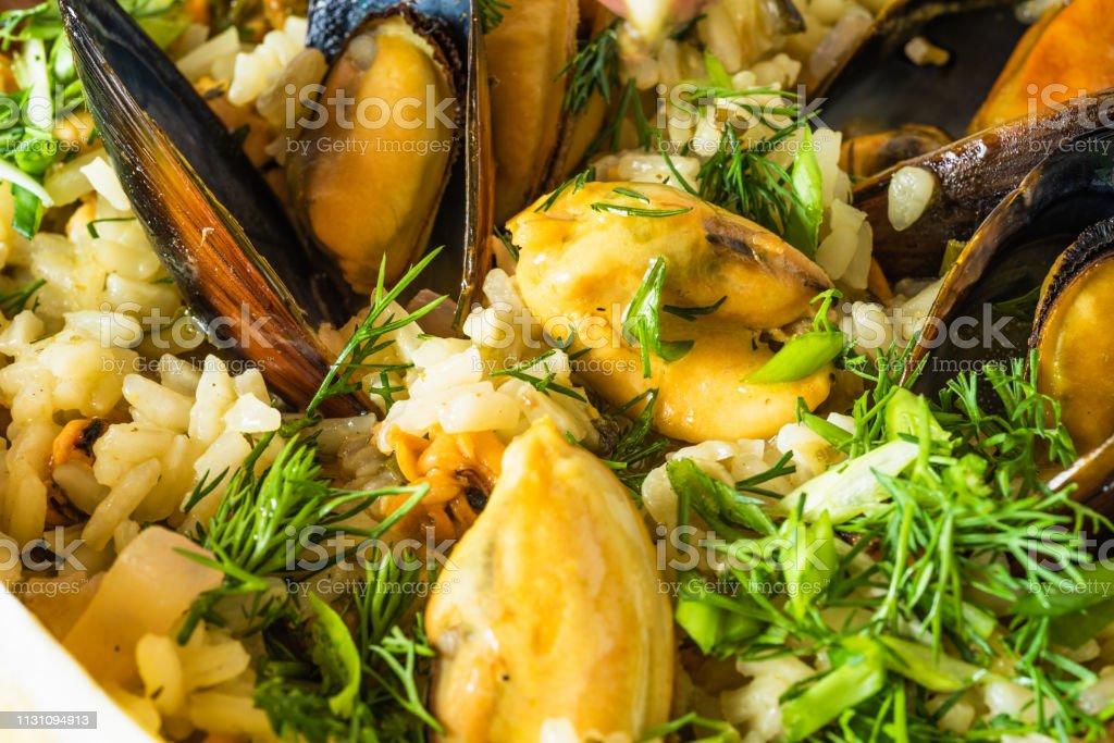 Lemon rice with mussels, midopilafo close up, macro - greek dish