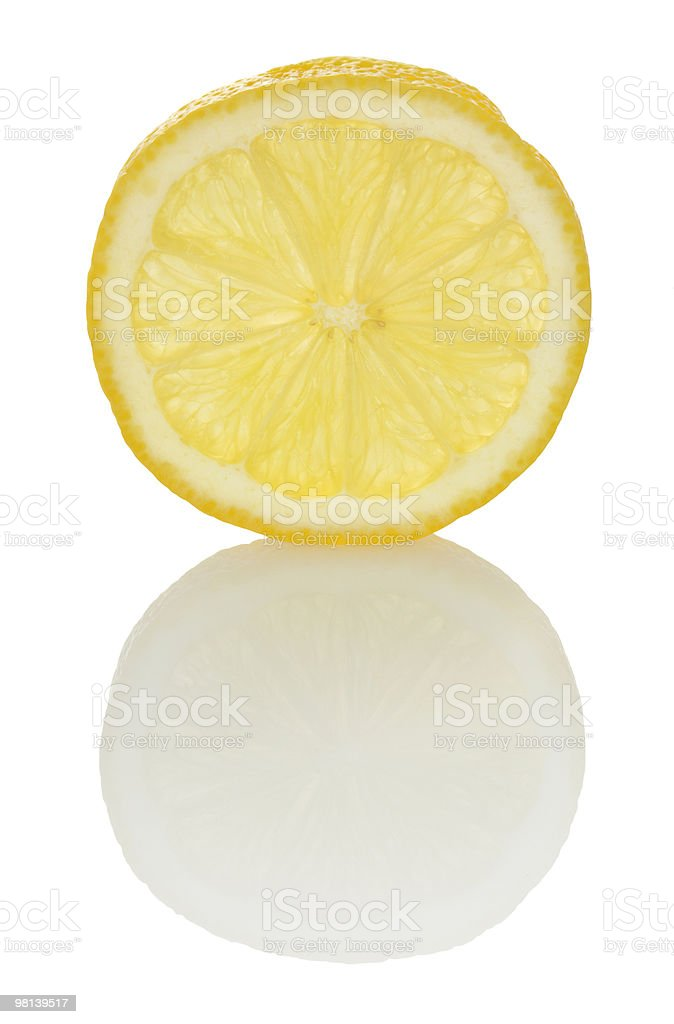 lemon slice and faint reflection royalty-free stock photo