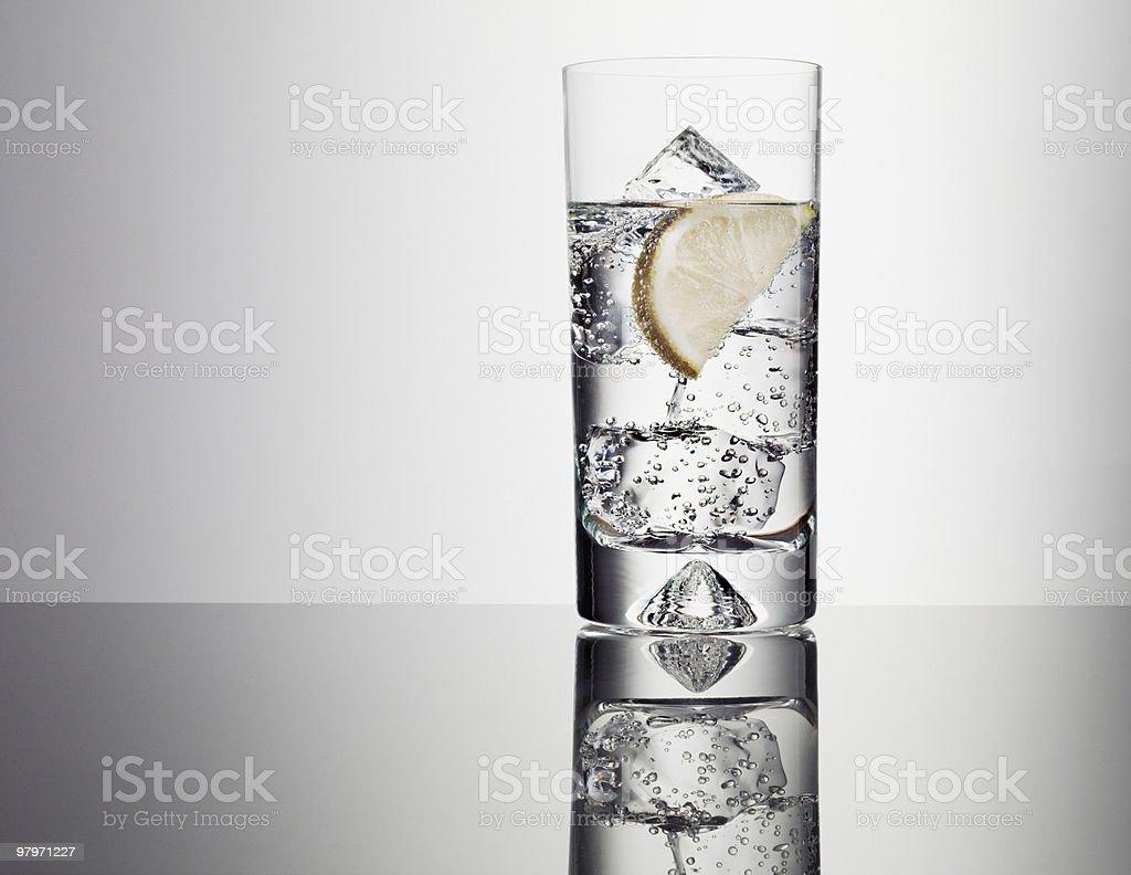 Lemon slice in glass of water royalty-free stock photo