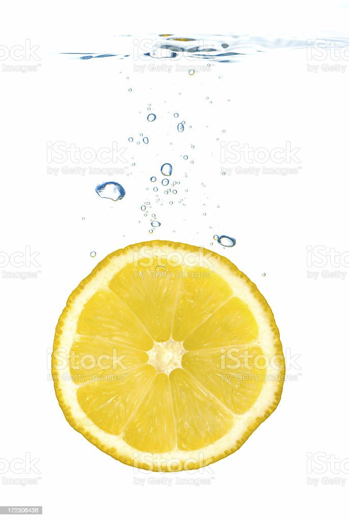 Lemon slice in water royalty-free stock photo