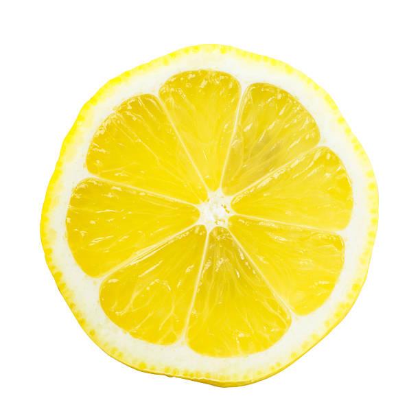 plasterek cytryny na białym tle na jasny żółty - cytryna zdjęcia i obrazy z banku zdjęć