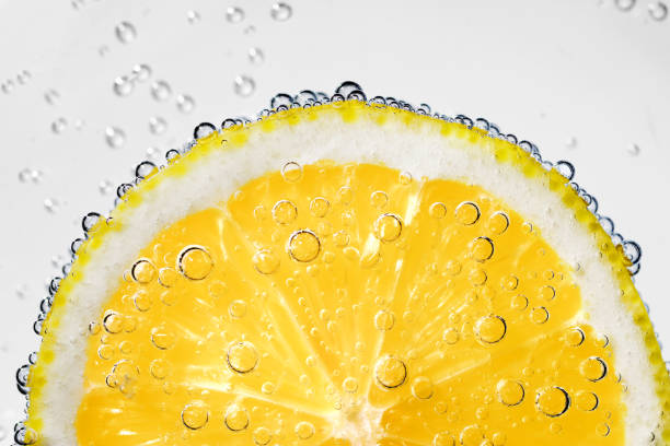 Lemon slice with bubbles stock photo
