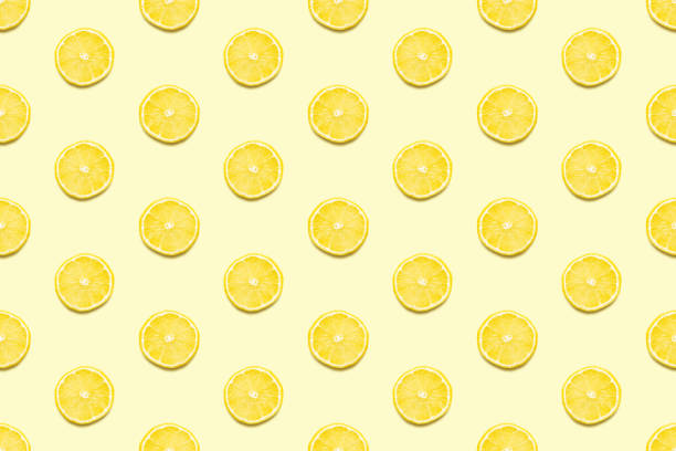 lemon slices seamless pattern on pastel yellow background minimal summer concept. - limone foto e immagini stock