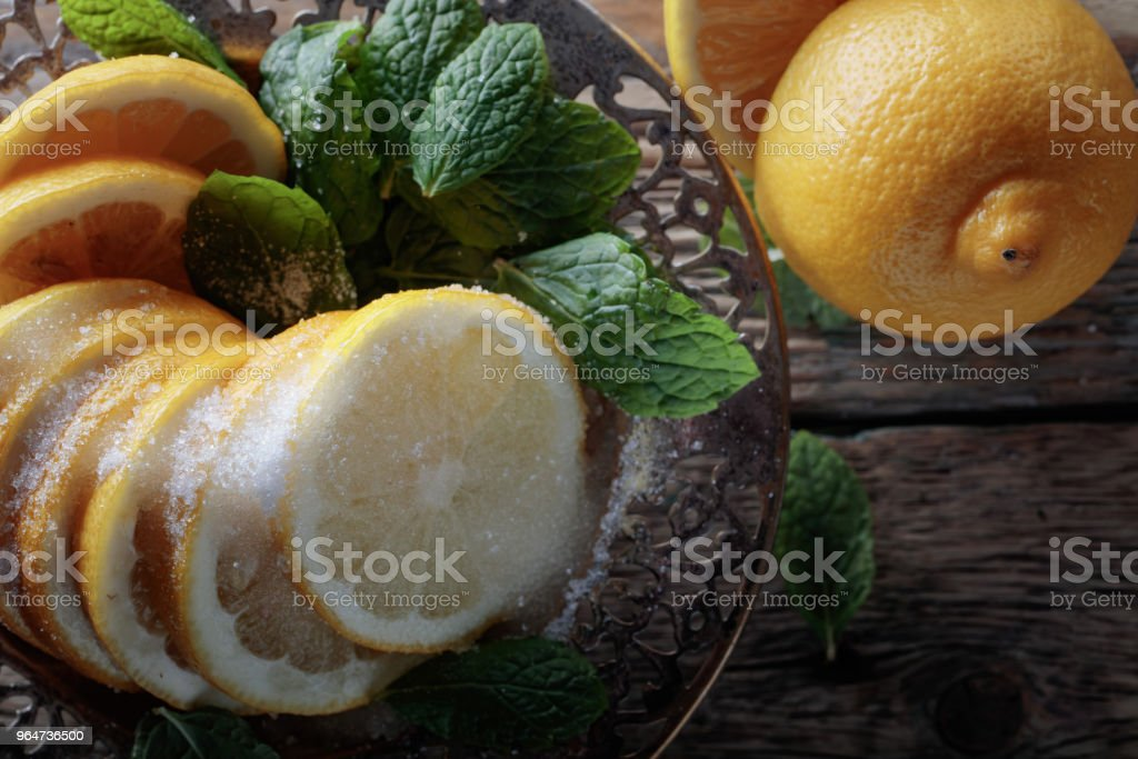 Lemon slices with sugar and mint leaves. royalty-free stock photo