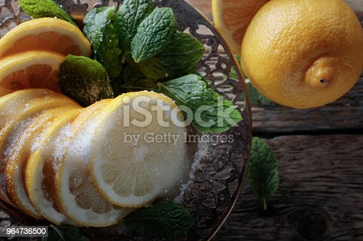 Lemon Slices With Sugar And Mint Leaves Stock Photo & More Pictures of Antioxidant