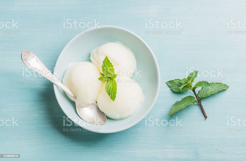 lemon sorbet ice cream with mint stock photo