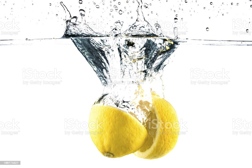 Lemon splashing in water royalty-free stock photo