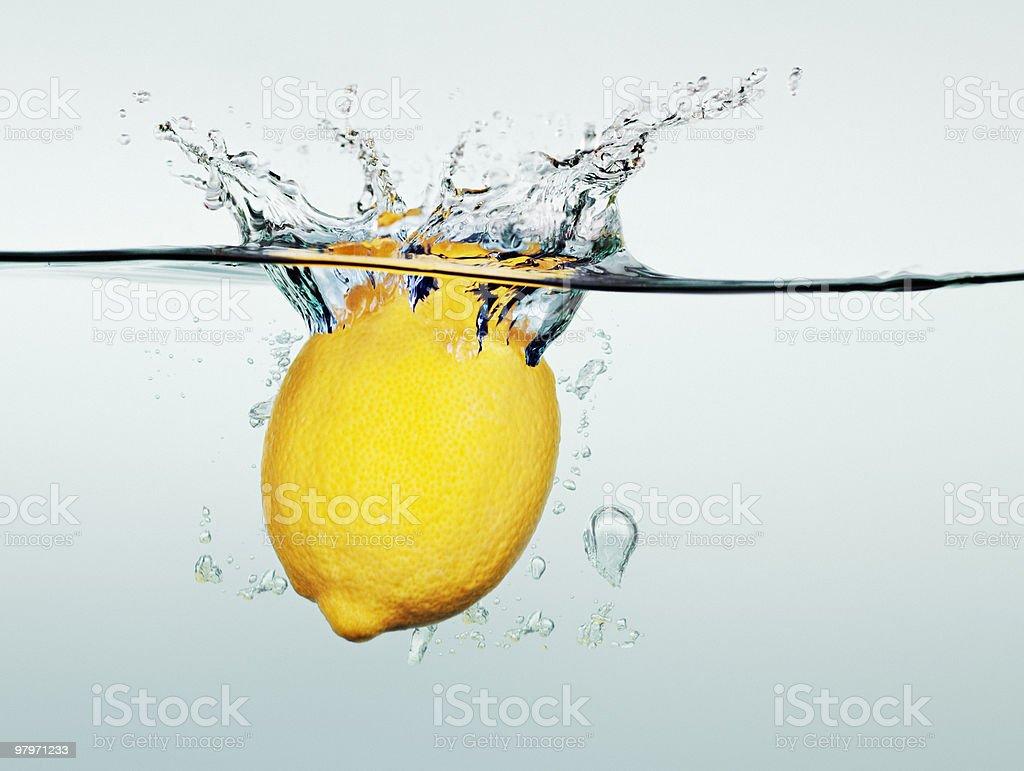 Lemon splashing in water royalty-free stock photo