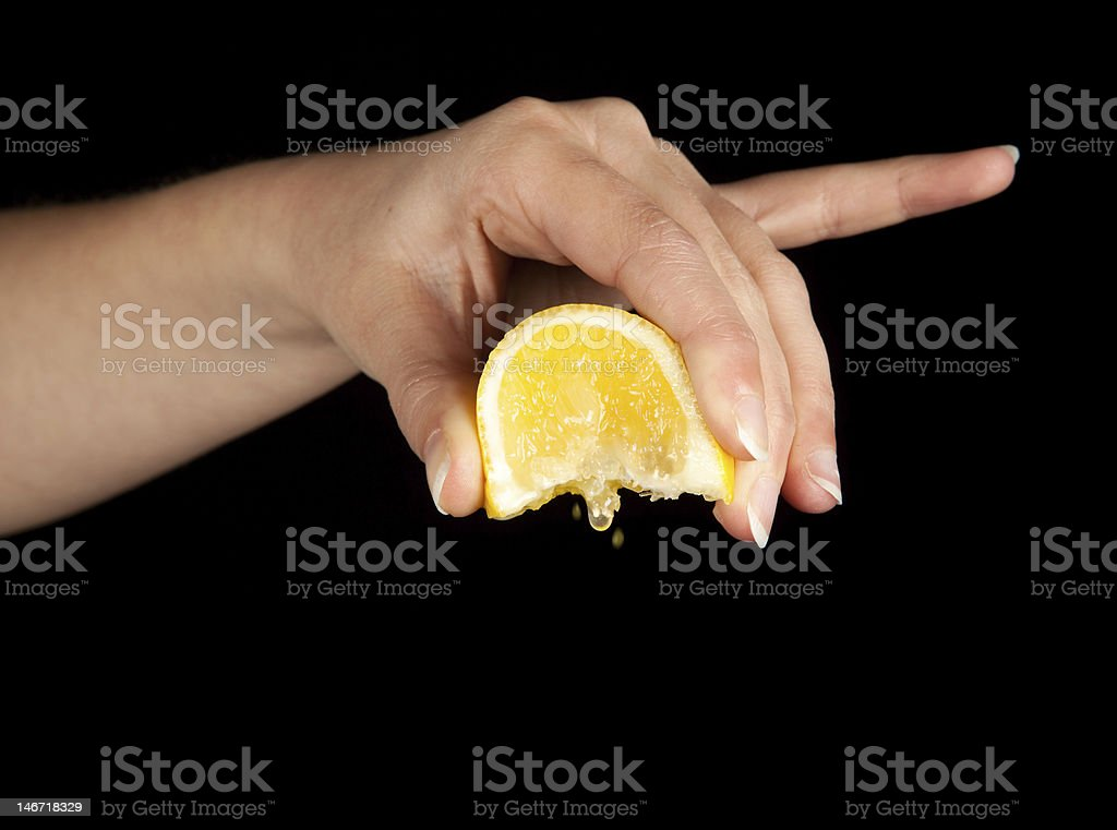 Lemon squeezing stock photo