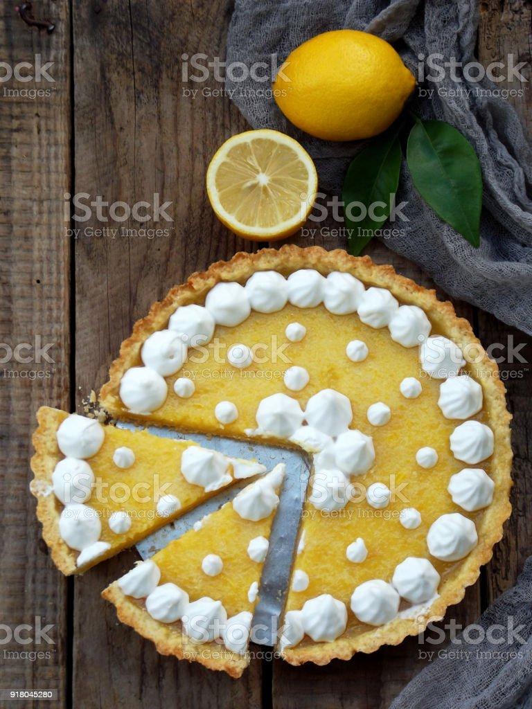 Lemon tart pie with meringue cream. Traditional American cake. Homemade baking. Copy space stock photo