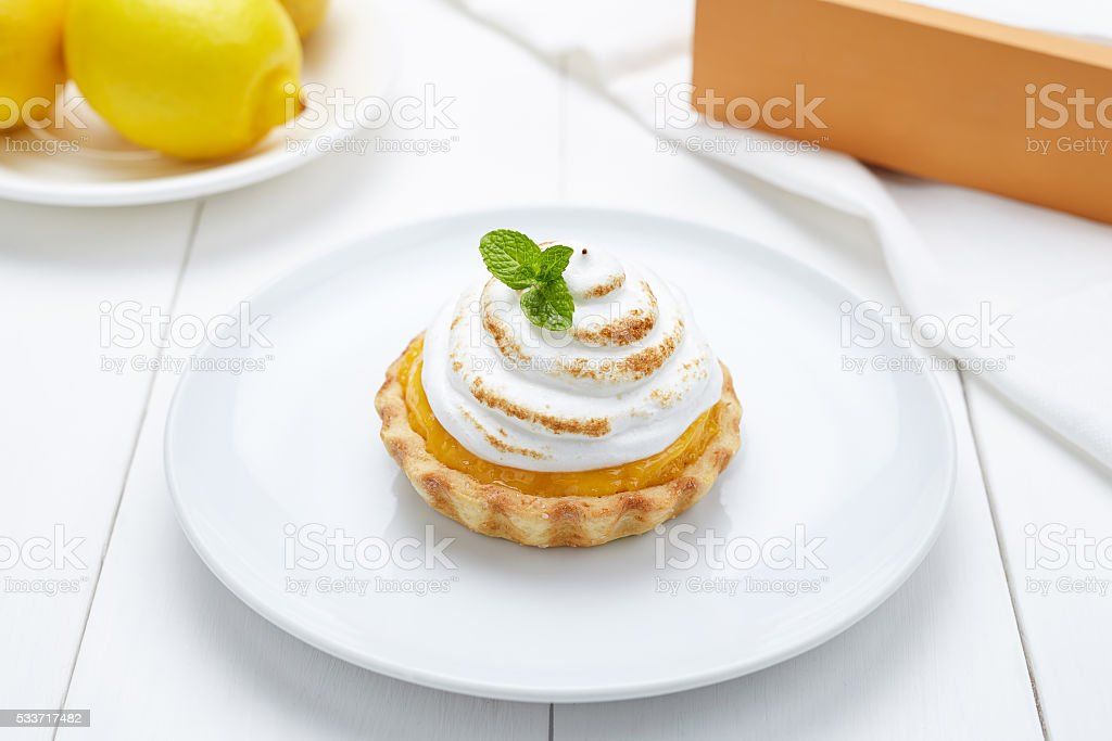 Lemon tart with whipped cream and mint sweet dessert stock photo