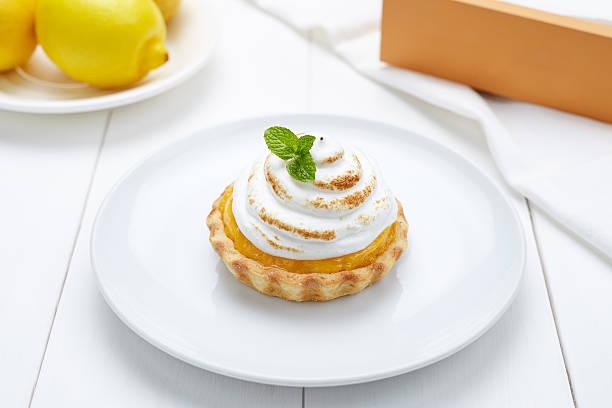 Lemon tart with whipped cream and mint sweet dessert stock photo