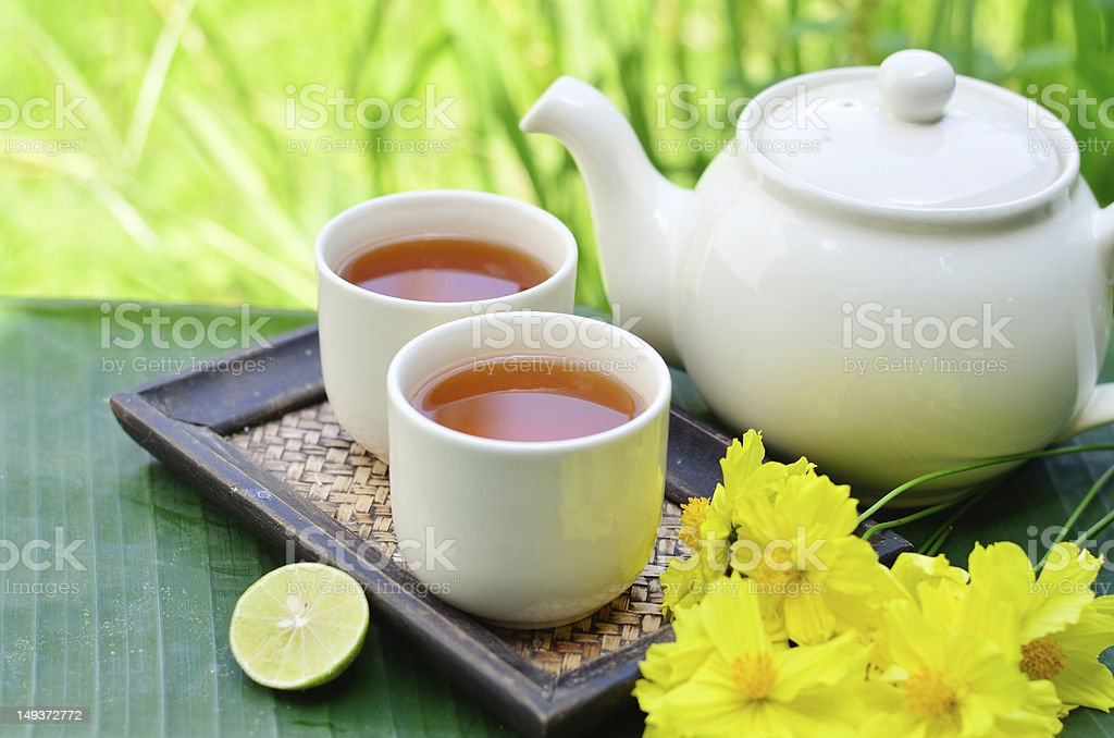 lemon tea whit yellow flowers royalty-free stock photo