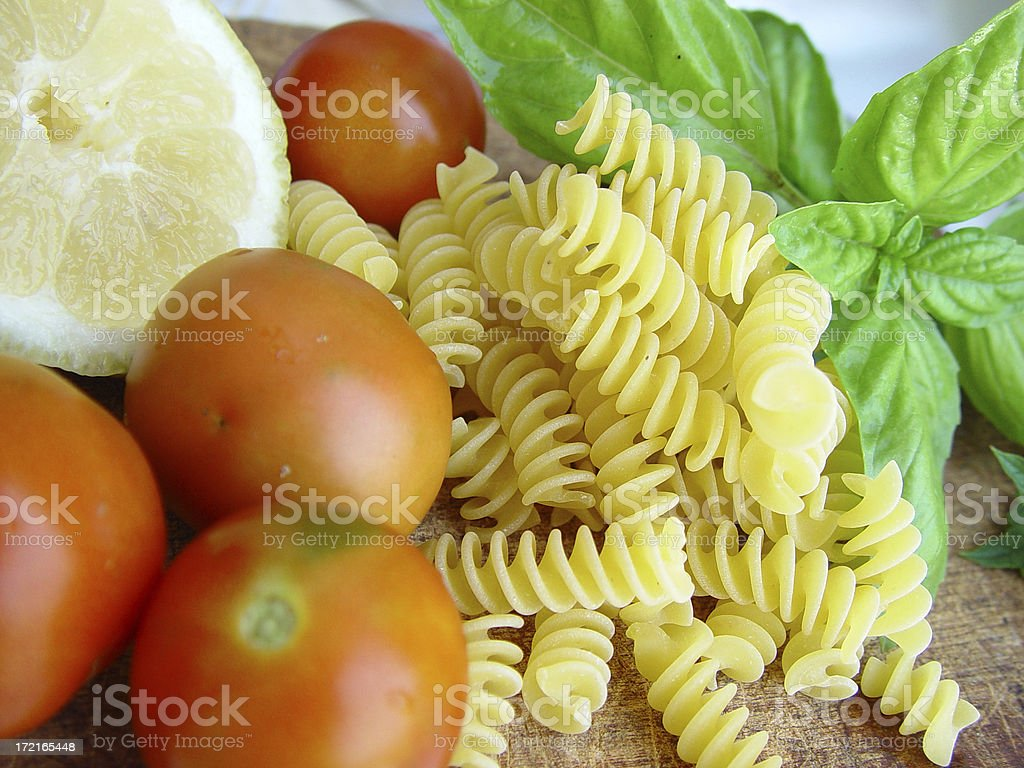 Lemon, Tomatoes, Basil and Pasta royalty-free stock photo