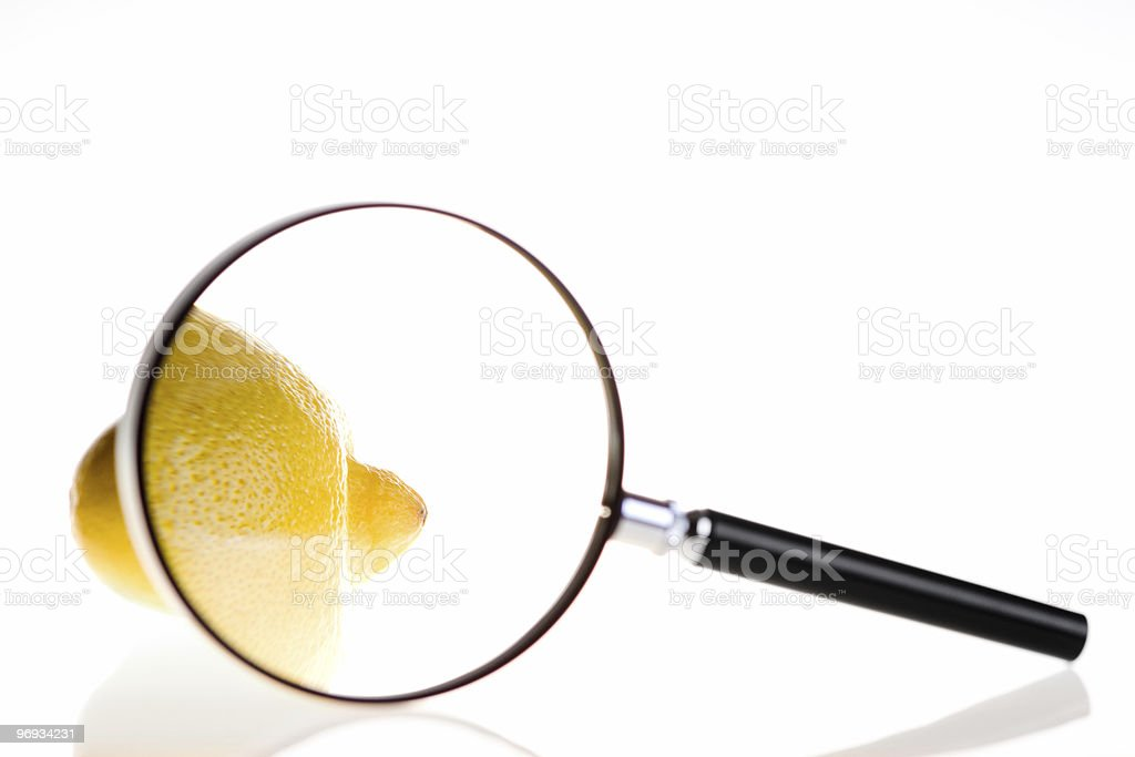 Lemon under magnifying glass  Black Color Stock Photo